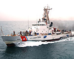 050427-N-1825E-084 Persian Gulf (April 27, 2005) – Coast Guardsmen aboard U.S Coast Guard Cutter Monomoy (WPB 1326) wave good-bye to the guided missile cruiser USS Antietam (CG 74) after the first underway fuel replenishment (UNREP) between a U.S. Navy cruiser and a U.S. Coast Guard Cutter. Antietam completed fuel replenishment with the Monomoy in about two hours and saved the 110-foot patrol boat a four-hour trip to the nearest refueling station. Antietam and Monomoy are conducting maritime security operations (MSO) in the Persian Gulf as part of Commander, Task Force Five Eight CTF-58). U.S. Navy photo by Journalist Seaman Joseph Ebalo (RELEASED)